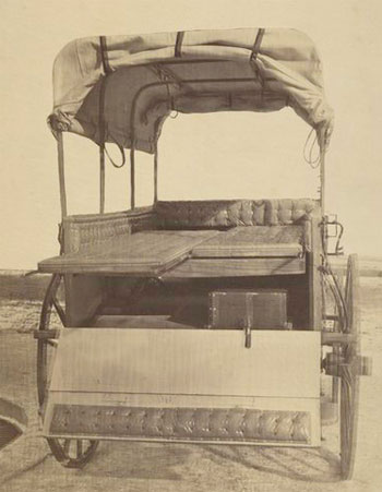Howard ambulance, rear view, tailgate down, with litters, water tank with spigot underneath (c. 1864-65, George E. Pell, US Sanitary Comm., NYPL)