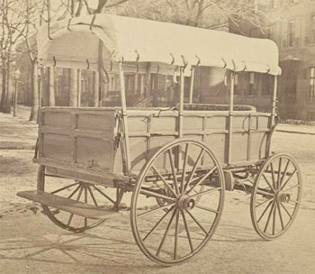 Howard ambulance, rear and side view, tailgate up, on city street (c. 1864-65, George E. Pell, US Sanitary Comm., NYPL)